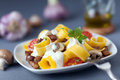 Delicious italian cuisine of pappardelle noodles or pasta cooked with mushrooms and tomatoes and drizzled with a seasoned cream Stock Images