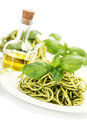 Delicious italian pasta with pesto sauce over white Stock Photography