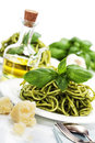 Delicious italian pasta with pesto sauce over white Royalty Free Stock Photography