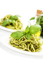 Delicious italian pasta with pesto sauce over white Royalty Free Stock Images