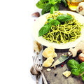 Delicious italian pasta with pesto sauce over white Stock Images