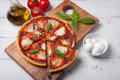 Delicious Italian pizza Margherita on a white wooden table. Top view Royalty Free Stock Photo