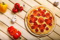 Delicious italian pizzas served on wooden table Royalty Free Stock Photo