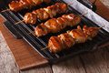 Delicious Japanese yakitori barbecue of chicken on a grill pan. Royalty Free Stock Photo