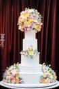 Delicious luxury white wedding cake decorated with cream flowers Royalty Free Stock Photo