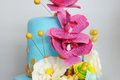 Delicious multicolor wedding cake decorated with pink flowers Royalty Free Stock Photography