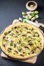 Delicious mushroom quiche on black Royalty Free Stock Photo