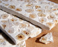 Delicious nutty white nougat Stock Images