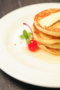 Delicious pancakes with cheery close up Royalty Free Stock Photography
