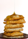 Delicious pancakes with honey fried added Royalty Free Stock Image