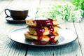 Delicious pancakes with raspberries sauce on the wooden kitchen table Stock Photo