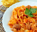 Delicious pasta with beans and sausages on the white plate pasta and beans pasta e fagioli pasta fazool is a traditional meatless Stock Photo