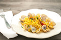 Delicious pasta with clams , mullet and pumpkin flowers Royalty Free Stock Photo