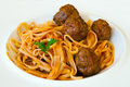 Delicious pasta with meatballs close up macro shot using shallow depth of field Royalty Free Stock Images