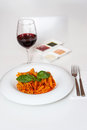 Delicious pasta and red wine served for dinner yummy with sauces Royalty Free Stock Image