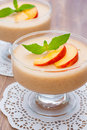 Delicious peach mousse in glass white serviette wooden backrgound Stock Images