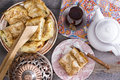 Delicious picnic eats with borek and turkish tea view from above of a serving of slices of on an authentic domed plate on an old Royalty Free Stock Photo