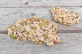 Delicious pieces of nougat with variety dried nuts on wooden table Royalty Free Stock Photos