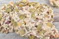 Delicious pieces of nougat with variety dried nuts on wooden table Royalty Free Stock Photography