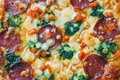 Delicious pizza with corn, broccoli and salami as background Royalty Free Stock Photo