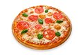 Delicious pizza with mozarella and tomatoes margherita italian thin pastry crust at white background on wooden desk Stock Photo