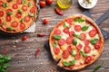 Delicious pizzas on  table Royalty Free Stock Photo