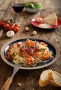 Plate of delicious spaghetti with shrimps and parmesan cheese, overhead view Royalty Free Stock Photo
