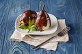 Delicious poached pears with chocolate syrup ready to serve Royalty Free Stock Photo