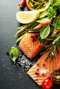 Delicious portion of fresh salmon fillet with aromatic herbs spices and vegetables healthy food diet or cooking concept Royalty Free Stock Image