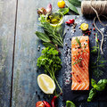 Delicious portion of fresh salmon fillet with aromatic herbs spices and vegetables healthy food diet or cooking concept Stock Images
