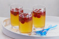 Delicious raspberry cocktail or dessert chilled refreshing served in glasses on a tray with blue plastic teaspoons Stock Photos