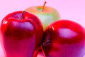 Delicious red apples and granny smith apple on backlighing Stock Photography