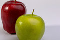 Delicious red apples and granny smith apple on white background Royalty Free Stock Photos