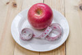 Delicious red apples and measured the meter on wooden background diet concept healthy food Royalty Free Stock Photo