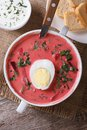 Delicious red beet soup with egg and sour cream top view Royalty Free Stock Photo