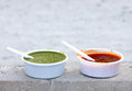 Delicious red and green mint chutney is mixture of spices vegetables or fruits taken with snacks Stock Photography