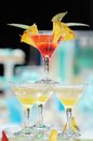 Delicious red and yellow cocktail tower with fresh pineapple party Royalty Free Stock Images