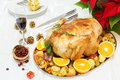 Delicious roasted turkey on christmas decorated table viewed from above Stock Photos
