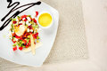 Delicious salad on dish with sauce Royalty Free Stock Images