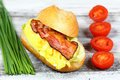Delicious sandwich with bacon, scrambled egg and lettuce Royalty Free Stock Photo