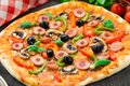 Delicious sausage pizza with mushroom paprika and olives Stock Photos