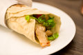 Delicious shawarma rolled sandwich with meat and vegetables Royalty Free Stock Photo