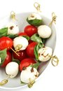 Delicious skewer boccocini cherry tomatoes basil caprese Royalty Free Stock Images