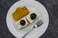Delicious slice of blueberry cheesecake on white dish Stock Photography