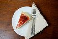 Delicious slice of cheesecake with strawberry sauce Royalty Free Stock Photo