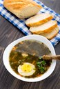 Delicious soup with sorrel egg on white bowl Stock Images