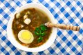 Delicious soup with sorrel egg on white bowl Stock Image