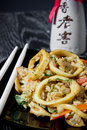 Delicious squid fried rice vegetables black plate asian food Royalty Free Stock Images