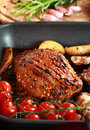 Delicious steak with grilled vegetable and mushrooms Royalty Free Stock Images