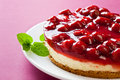 Delicious strawberry cheese cake with fresh mint Royalty Free Stock Image